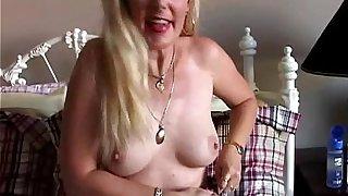 Super sexy blonde MILF in suspenders enjoys a sticky facial cumshot