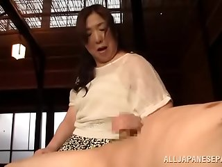 Japanese woman pleases her boy a handjob